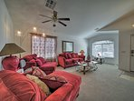 Relax on the plush sofas under the ceiling fan.