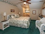 Queen bed with full bath, shower and garden tub.