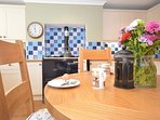 Lovely Aga adding character to this stylish kitchen/diner
