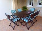 Mesa y 6 sillas de madera de teka