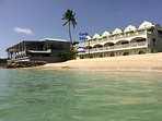 Coral Sands apartment and Hugos restaurant as seen from the beach