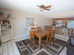Savor a Meal with the Family in this Spacious Dining Area with seating for 6 and Ocean Views