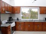 Fully Stocked Kitchen w/Fridge, Stove, Coffee Maker, Cooking/Eating Utencils, and Microwave Oven!