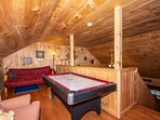 Upstairs loft area with Air Hockey Table, Futon available for extra sleeping guests and King Size Bed