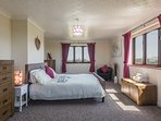 Our very spacious master bedroom has a kingsize bed & views in 3 different directions.
