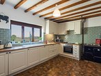 Fully fitted kitchen with separate fridge and freezer, dishwasher and electric oven & hob.