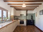 Farmhouse kitchen/diner with plenty of space to seat 8 adults plus a highchair (which is provided)