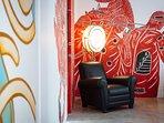 Villa Canggu - Villa North bedroom two corner chair and art