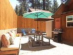 Backyard with picnic table that seats 6, umbrella, brand-new gas BBQ, lounge chairs, bench (25x100) with cushions and...