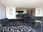Beautiful monochrome lounge area, onto open plan dining