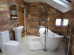 One of three bathrooms: stand alone bath and wet room
