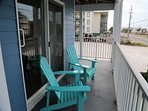 Sunchase 111 - Lounge in the outdoor chairs on the breezeway by the sliding doors of 111