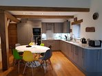 Contemporary kitchen diner with NEFF appliances and seating for 8.