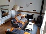 Oak beamed living room with wood burner, smart TV and 70mbps super fast broadband