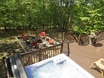 Private rear deck with hot tub and fire pit