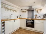 The well presented kitchen is ideal for home cooking