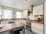 Fully-fitted kitchen with Smeg cooker, w/machine, dishwasher and large fridge-freezer