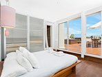 The master bedroom has direct access to the main terrace