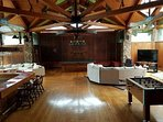 Large family room with panoramic views. Pool table, foosball, bar area and a fireplace.