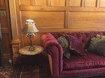 Red velvet sofa in the Grand Foyer.