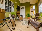 The insect screened front porch is ideal of playful conversations and planning daily activities.