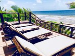 New beach side sunbathing deck with seating, set upon a sand dune.