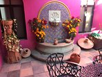 Traditional artwork, Talavera tiles and handmade fountain.