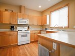 Kitchen with full size refridgerator, drip coffee maker, dishwasher and more