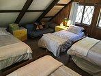 4 twin beds on third floor loft