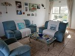 Lounge and dining room combined with combi memorabilia