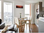Beautiful sitting-dinning room with lot of light. Broad terrace with great view
