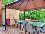 Deck with gazebo, table and chairs.