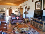 Large open-plan home facilitates family interactions, socialization, and full mountain views.