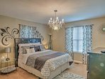 This master bedroom offers a plush queen bed.