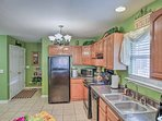 The fully equipped kitchen has all necessary cooking appliances.