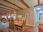 The interior of the home welcomes you with beautiful wood beams.