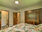 The master bedroom includes an en-suite half bathroom.