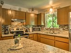 The kitchen is well-equipped with stainless steel appliances.
