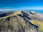 Cadair Idris the the closest serious climb, allow 5 hours, the views make it worth the walk