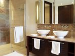 Ensuite bathroom with double sinks and a large walk in shower.