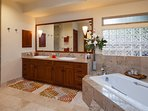 Master bathroom with massive tub, double sink, shower and outdoor courtyard shower