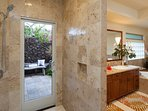 Master shower leads to outdoor shower courtyard