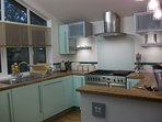 The bright kitchen has a range and all mod cons.