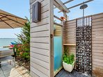 Outdoor shower on waterfront deck