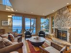 Living room with beautiful stone fireplace and floor to ceiling windows