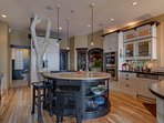 Kitchen with dual gas ranges, dual ovens, dishwasher and oversized refrigerator