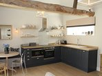 The kitchen area is well equipped with hob, dishwasher, microwave and fridge