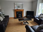 Living room with luxurious leather suite. Also wood burner for those winter breaks.