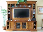 entertainment center with large HDTV; DVD; Cable; wifi; phone; etc.