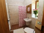 Wet room is kept warm in winter with double insulated walls. You can turn the heat down not up!